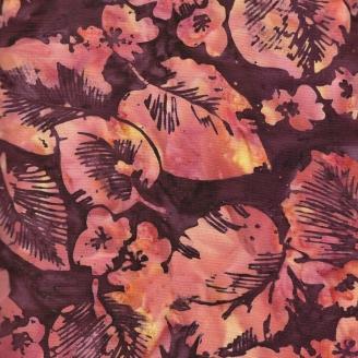 Tissu batik feuilles tropicales orangé fond prune