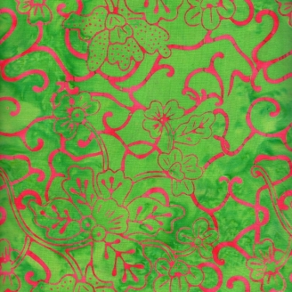 Tissu batik fleurs exotiques roses fuchsia fond vert