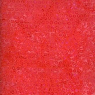 Tissu batik cercles magenta fond rouge