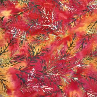 Tissu batik branchages verts fond rouge orange