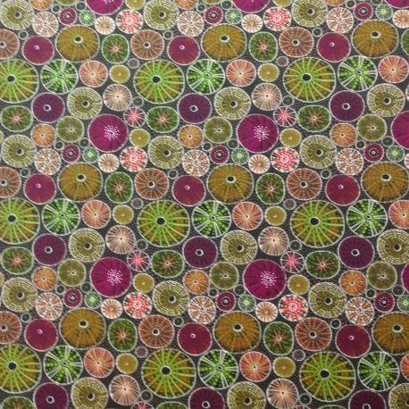 Tissu aborigène oursins prune et vert fond brun