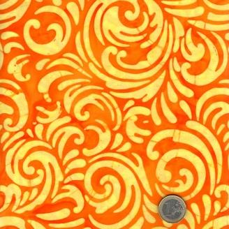 Tissu batik Kaffe Fassett arabesques jaunes fond orange