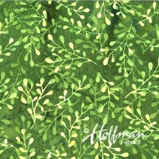 Tissu batik feuillage fond vert gazon