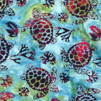 Tissu batik tortues bordeaux fond bleu vert