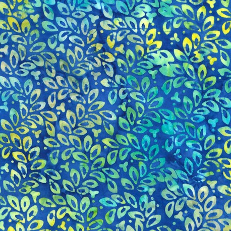 Tissu Batik feuillage vert/turquoise fond bleu