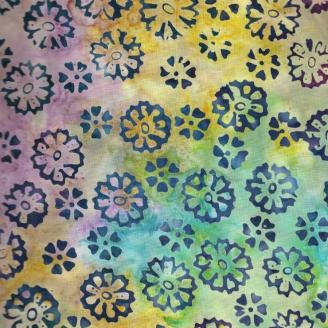 Tissu Batik pâquerettes marines fond multico turquoise/violine/jaune