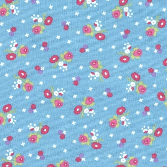 Tissu patchwork fleurs rouges fond bleu clair