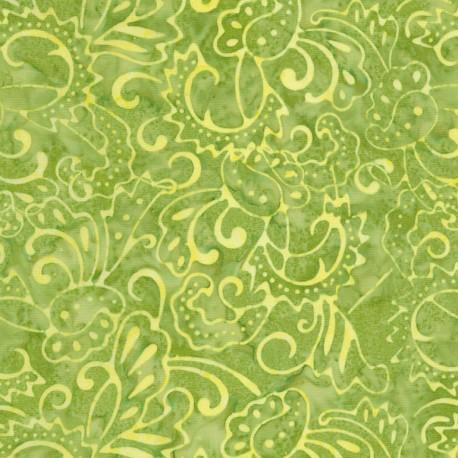 Tissu Batik arabesques jaunes fond vert poire