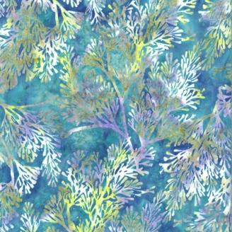 Tissu batik branchages violets fond bleu-vert