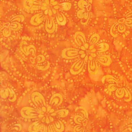Tissu batik fleurs virvoltantes oranges