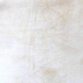 Tissu batik virgules écrues ton sur ton