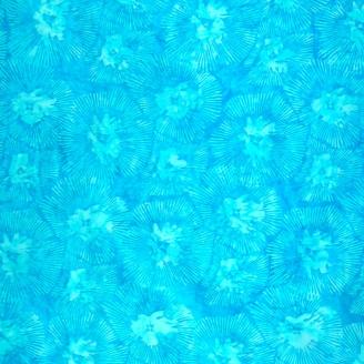 Tissu batik fleur rayonnante bleu turquoise