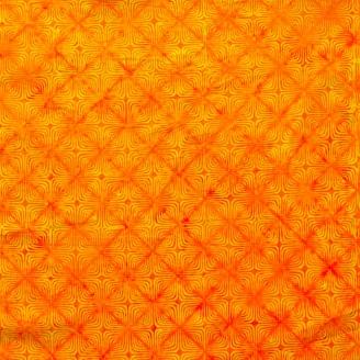 Tissu batik pétales géométriques orange