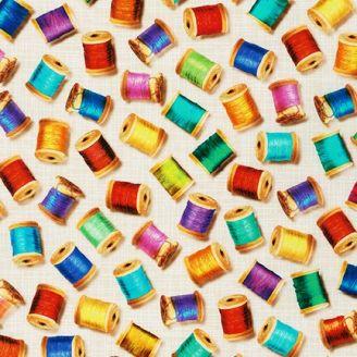 Tissu patchwork bobines de fils multicolores fond beige