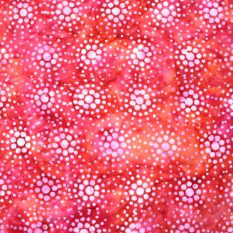 Tissu batik spray rose fond rouge orange