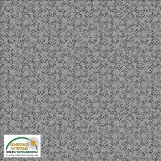 Tissu patchwork roues crantées fond gris argent