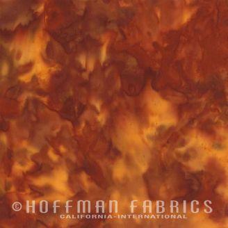 Tissu batik marbré orange brun paprika