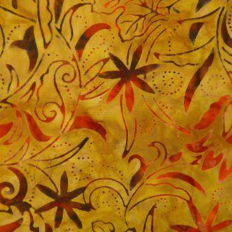 Tissu batik feuillage doré et marron