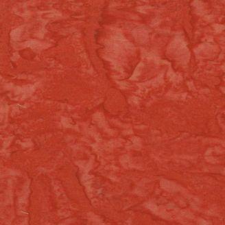 Tissu batik marbré orange rouge tomate