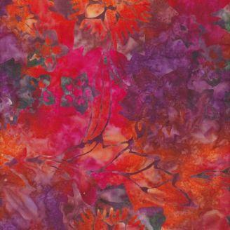 Tissu batik fleurs tropicales tons chauds fond orange