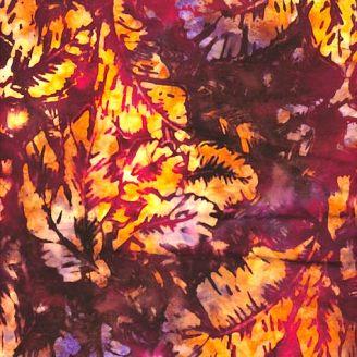 Tissu batik feuilles jaunes fond violine