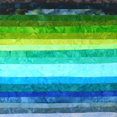 Joli roll de tissus patchwork batik marbrés Lagune