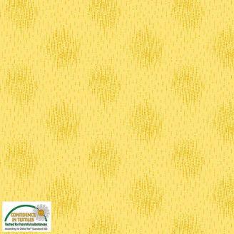 Tissu patchwork ronds brouillés fond jaune